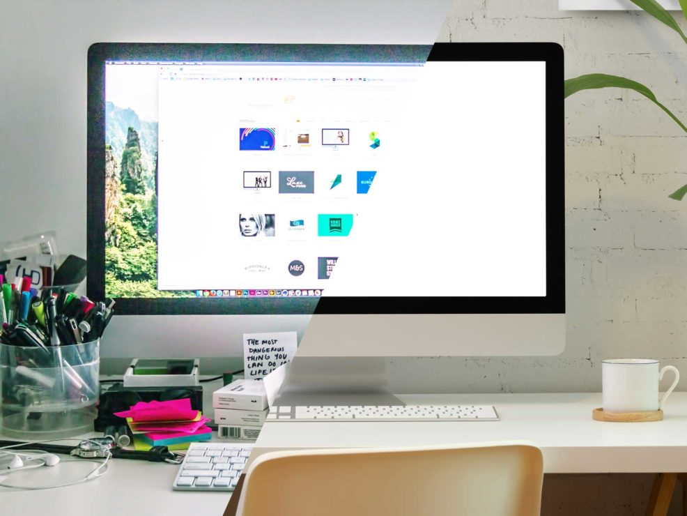 Image of a desk with apple computer showing left side clutter and righst side clean